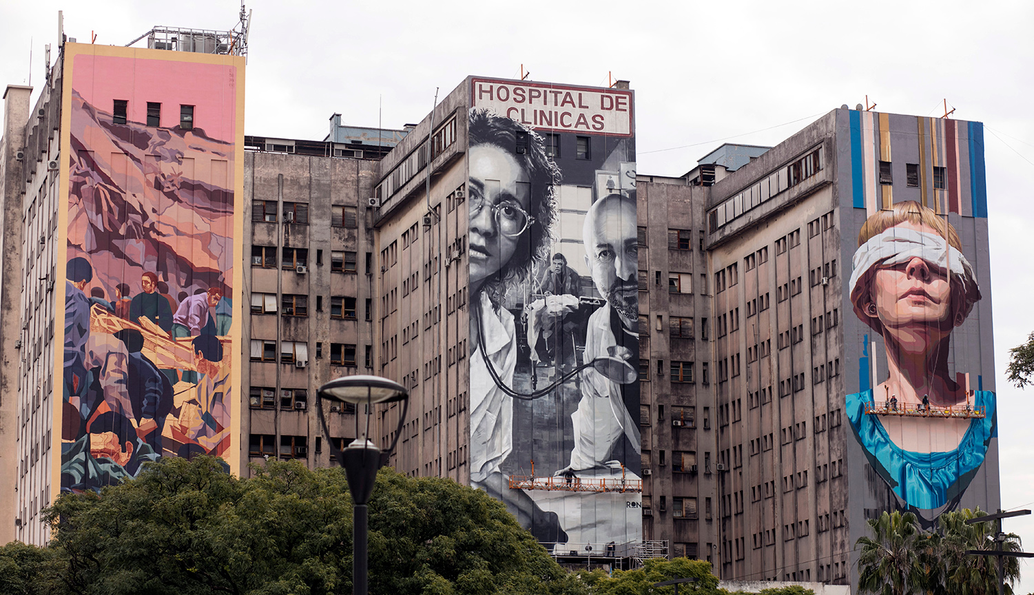 Three allegorical murals of the victims of the AMIA bombing on the façade of the Hospital de Clínicas on July 18, 2019 in Buenos Aires, Argentina. Ricardo Ceppi/Getty Images.
