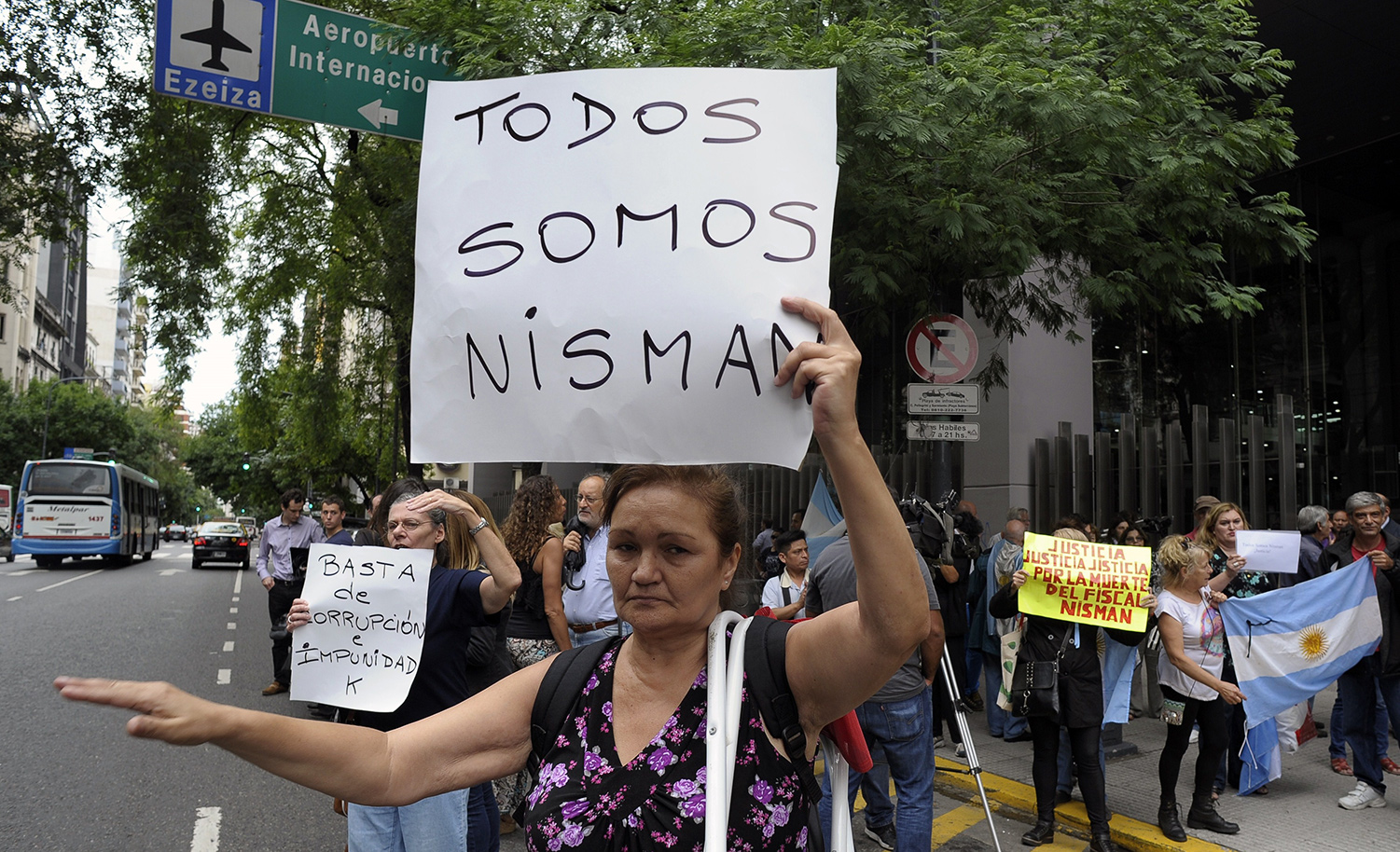 "Protestors with posters reading ""We Are All Nisman"" and ""Enough of Corruption and Impunity K"" (K referring to then-president Christina Kirchner) in Buenos Aires on January 19, 2015, days after the death of Argentine public prosecutor Alberto Nisman. ALEJANDRO PAGNI/AFP/Getty Images."