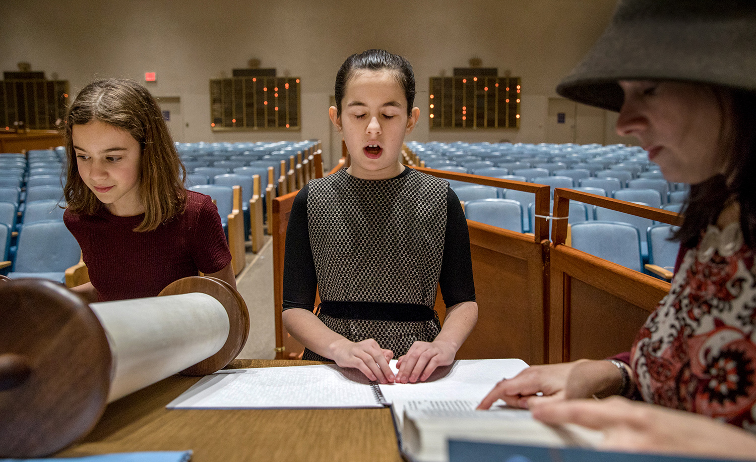 Batya Sperling Milner, who is blind, practices reading Torah with her aunt and a friend. Evelyn Hockstein/For The Washington Post via Getty Images.