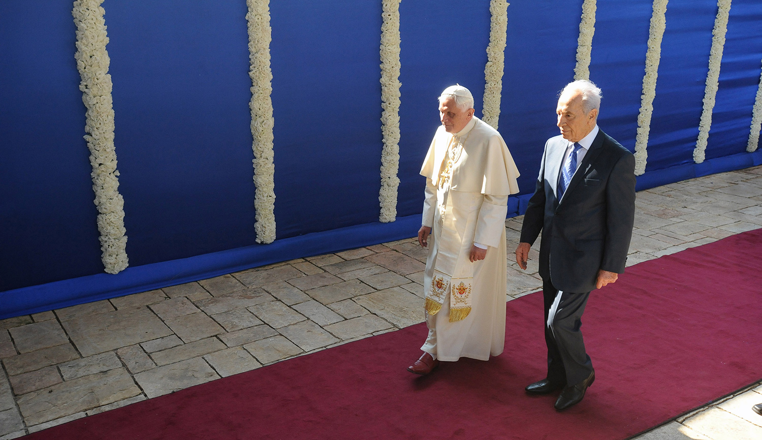 Then-Pope Benedict XVI with Shimon Peres, then president of Israel, in Jerusalem on May 11, 2009. Ahikam Seri/Bloomberg via Getty Images.