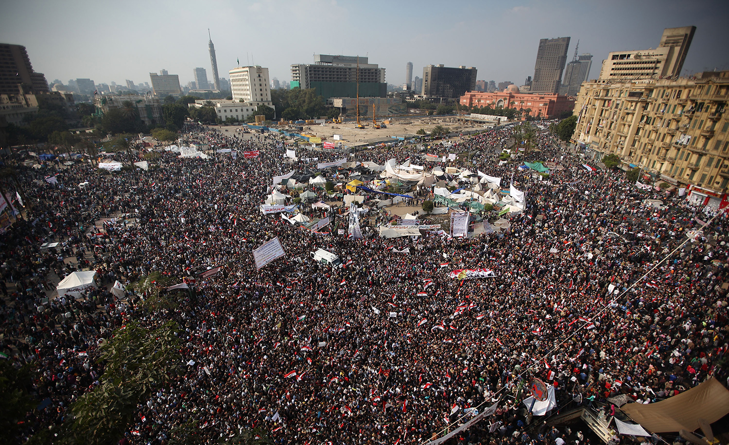 Protestors gathering on November 25, 2011 in Cairo, Egypt in one of the early protests of the Arab Spring. Peter Macdiarmid/Getty Images.