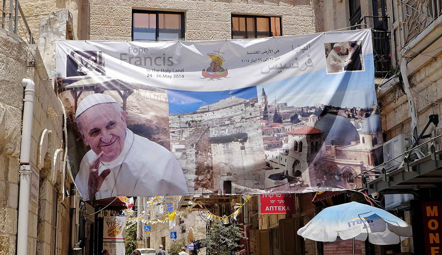 A banner welcoming Pope Francis hangs near the Old City in Jerusalem on May 28, 2014. AP Photo/Robert E. Klein.