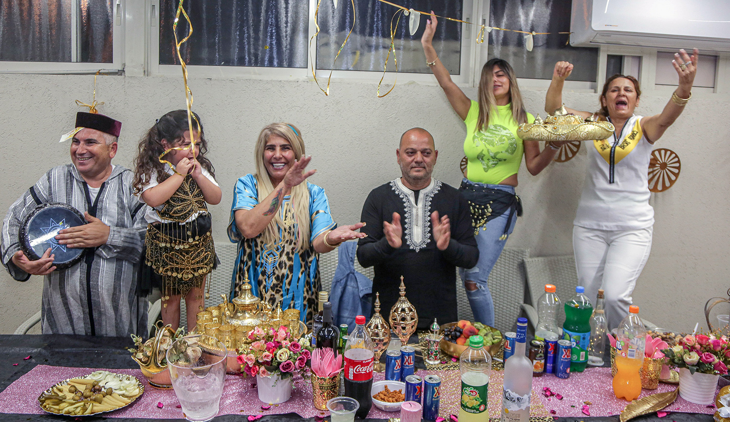 A family celebrating the North African Jewish holiday of Mimouna in the southern Israeli city of Ashkelon on April 15, 2020. Edi Israel/Flash90.