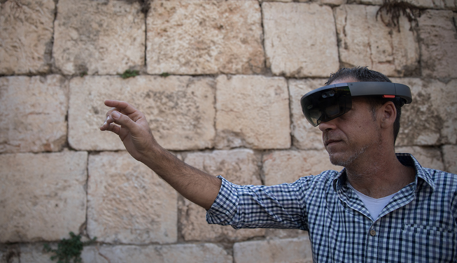A man looking through augmented reality glasses at the Tower of David Museum in Jerusalem's Old City on October 17, 2017. Hadas Parush/Flash90.
