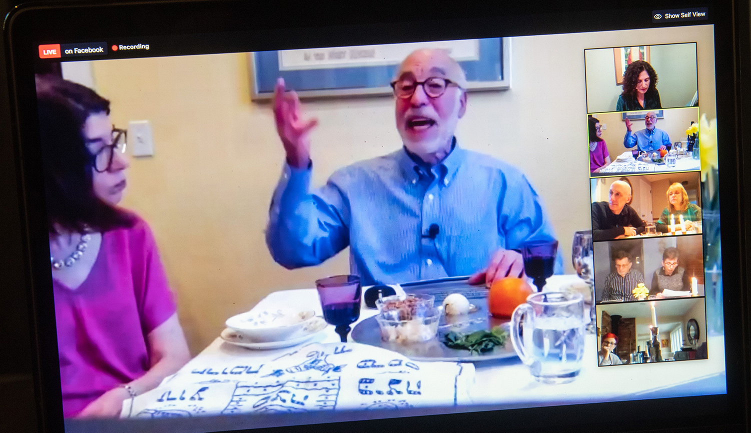A rabbi hosts a virtual community seder on Zoom during the first night of Passover on April 8, 2020. SAUL LOEB/AFP via Getty Images.