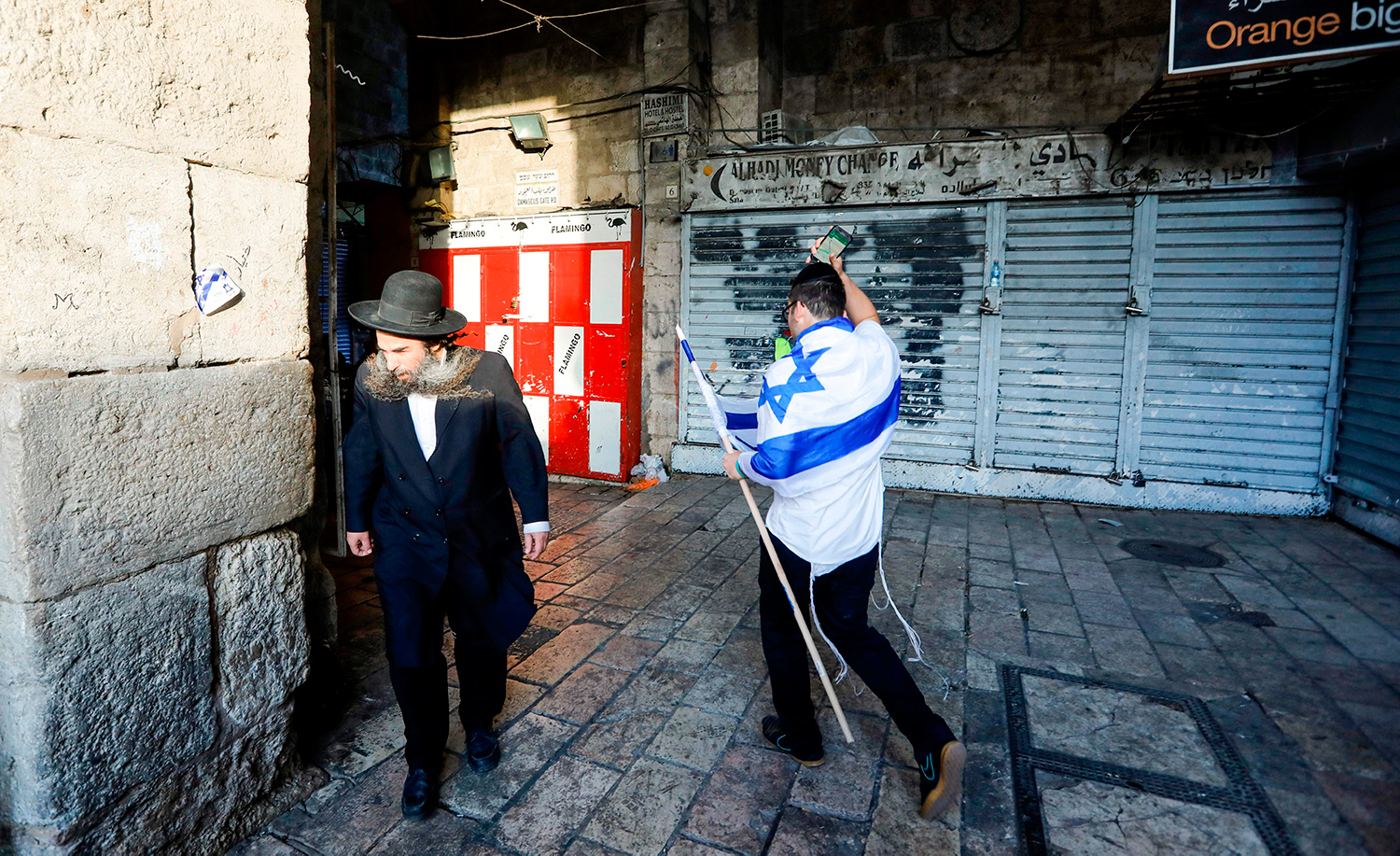 Two Jewish men in Jerusalem on May 13, 2018. MENAHEM KAHANA/AFP via Getty Images.