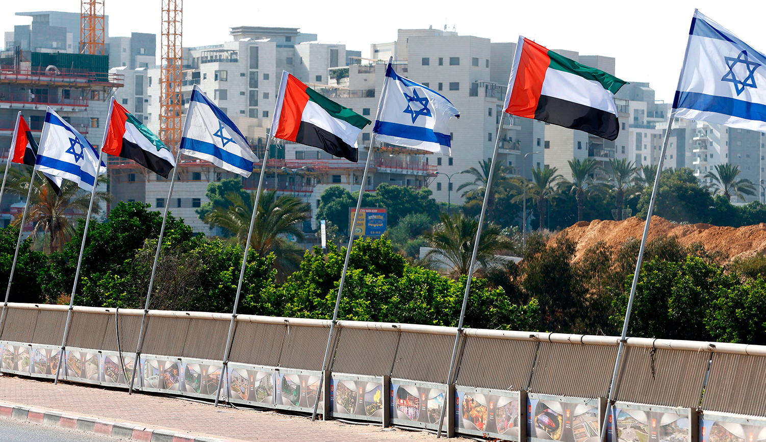 Israeli and United Arab Emirates flags line a road in the Israeli city of Netanya on August 16, 2020. JACK GUEZ/AFP via Getty Images.
