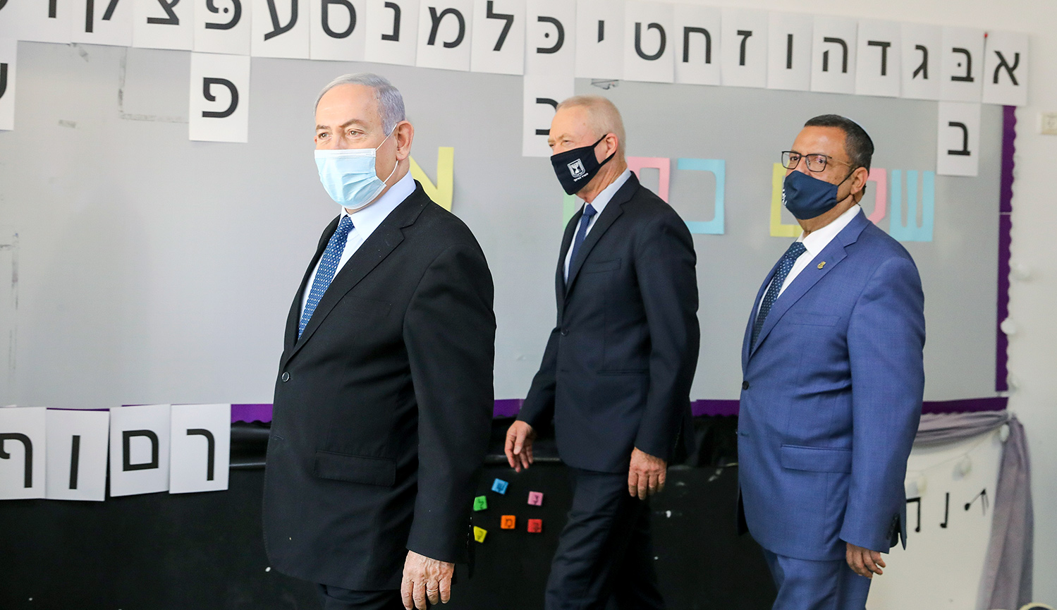 Israeli Prime Minister Benjamin Netanyahu and Minister of Education Yoav Galant visit at a school in Jerusalem ahead of the opening of the school year on August 25, 2020. Marc Israel Sellem/POOL.