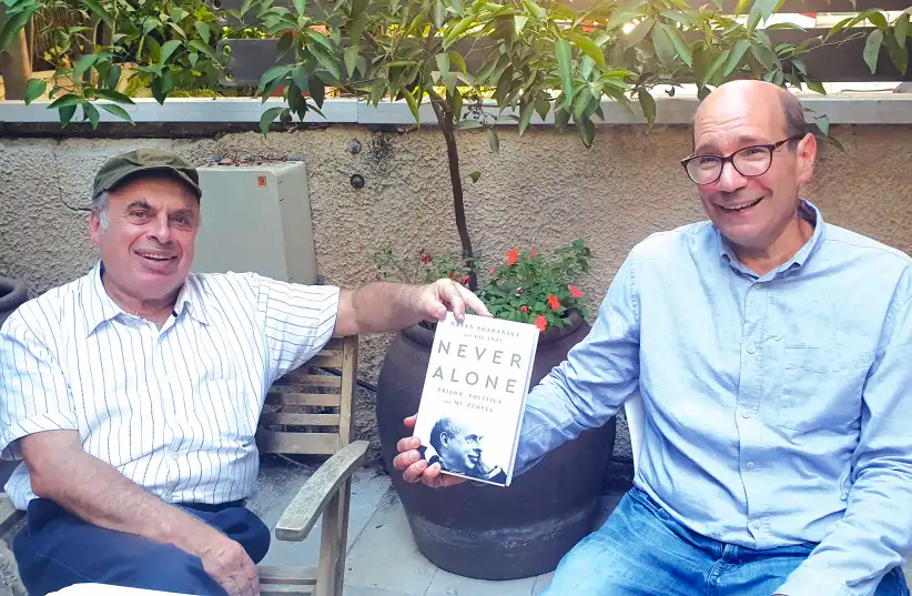 Natan Sharansky and Gil Troy with a copy of Never Alone, their new book. Larissa Ruthman.