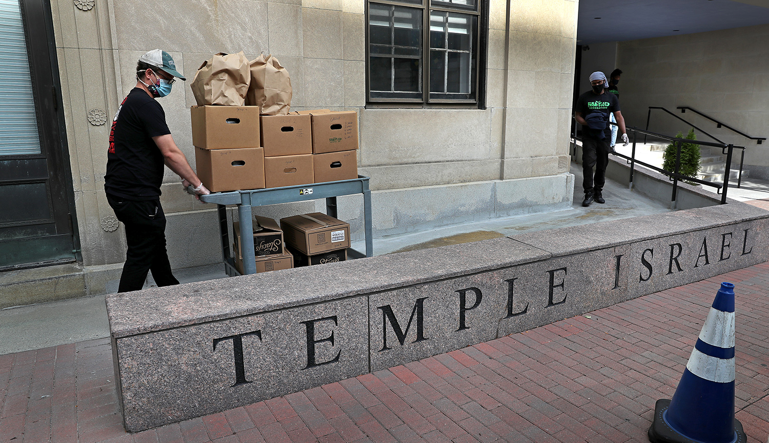 A team prepares meals at the Temple Israel synagogue kitchen in Boston on Sept. 1, 2020. David L. Ryan/The Boston Globe via Getty Images.