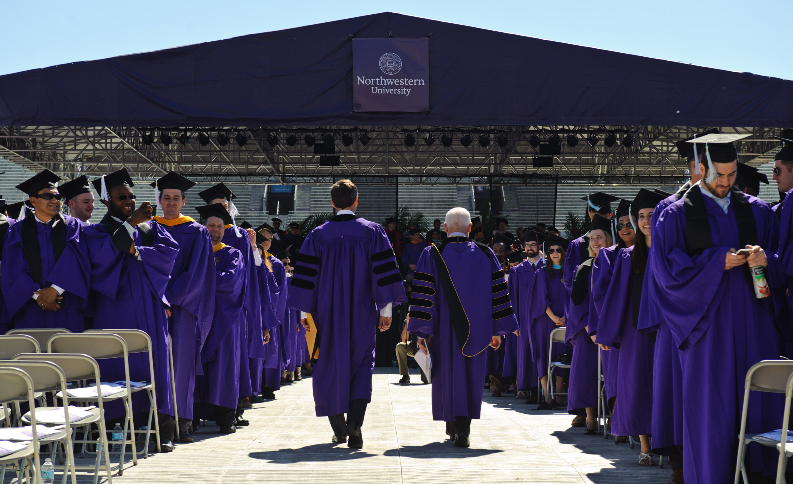 The comedian Seth Meyers (left) and Northwestern University President Morton O. Schapiro (right) at the university's 2016 commencement in Evanston, Illinois. Timothy Hiatt/Getty Images.