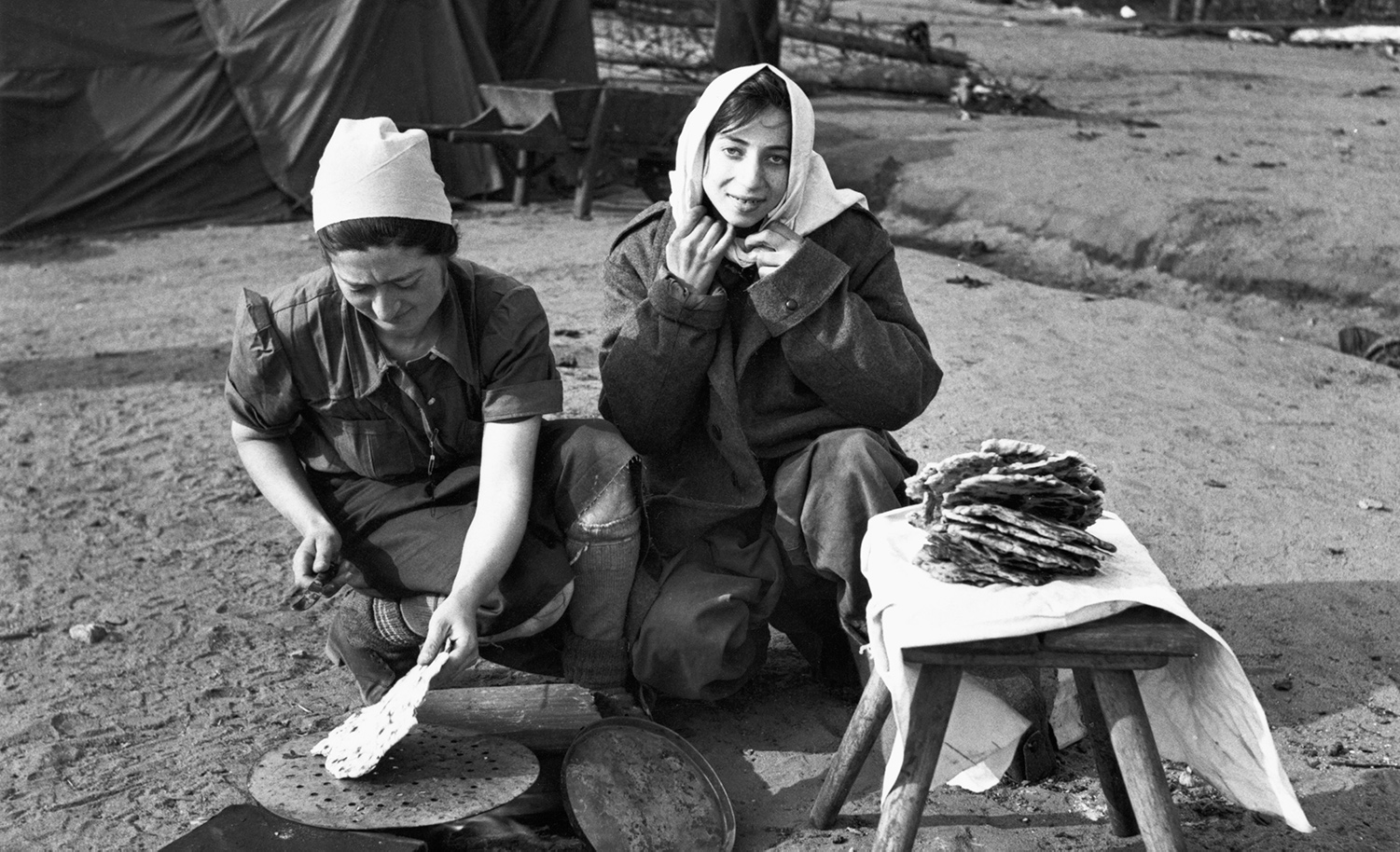 Women cooking flatbread at the liberated Bergen-Belsen concentration camp in 1945. George Rodger/The LIFE Picture Collection via Getty Images.