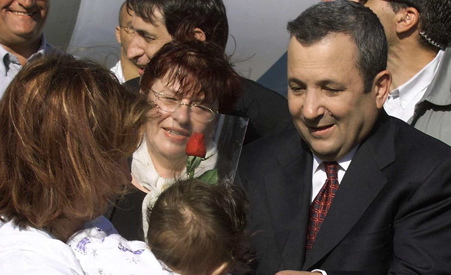 Israeli Prime Minister Ehud Barak greets immigrants arriving by plane from Moscow on May 7, 2000 in Tel Aviv. SVEN NACKSTRAND/AFP via Getty Images.