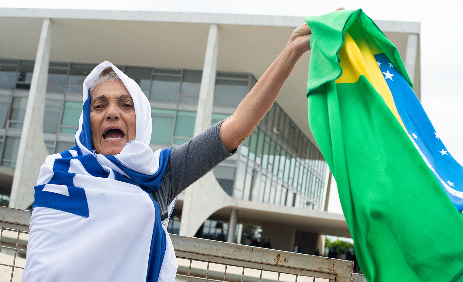A Brazilian woman wrapped in Israel's flag while holding the Brazilian flag in her hand on May 7, 2020 in Brasilia. Andressa Anholete/Getty Images.