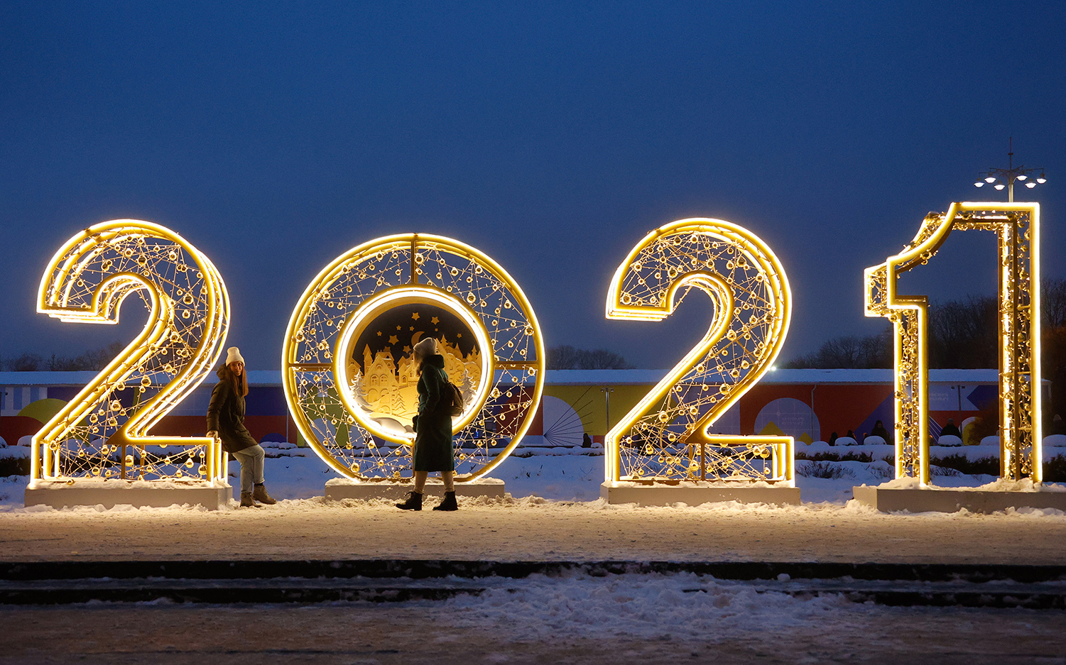 Two women at a light installation in Moscow's Gorky Park on January 7, 2021. Valery Sharifulin/TASS via Getty Images.