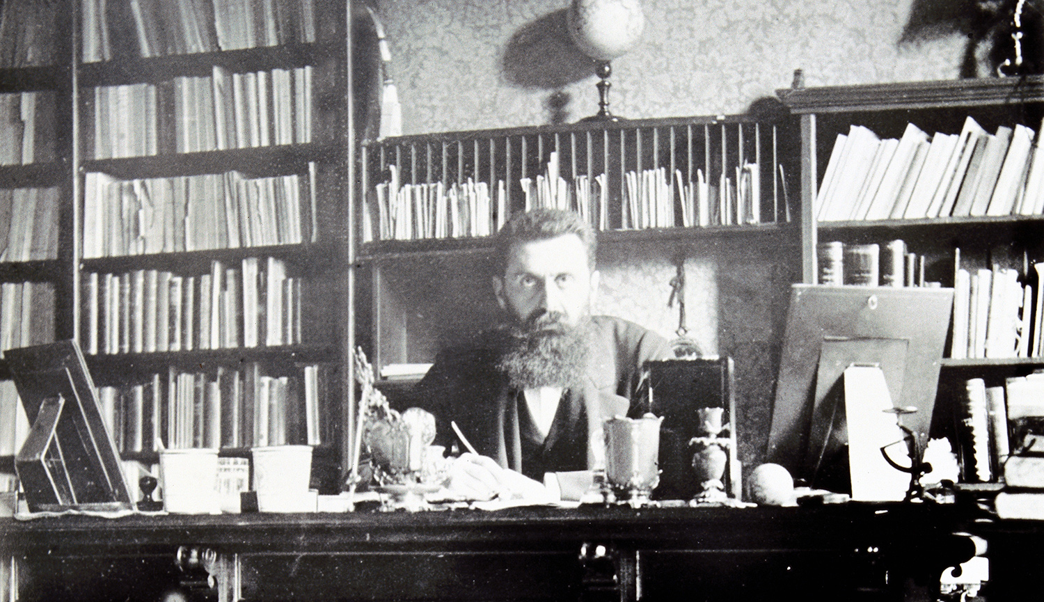 Theodor Herzl at his desk in Vienna around 1900. Imagno/Getty Images.