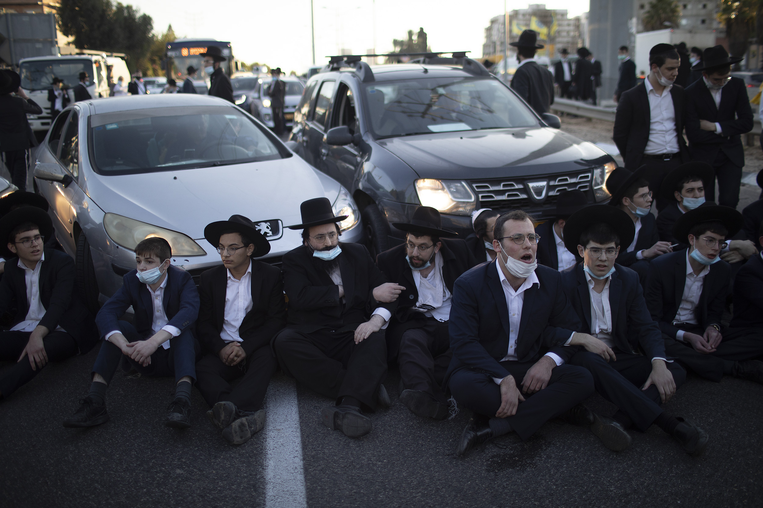 Ḥaredi Jews block traffic in the city of Bnai Brak as a protest against the Israeli government's third coronavirus lockdown on December 27, 2020. Ilia Yefimovich/picture alliance via Getty Images.