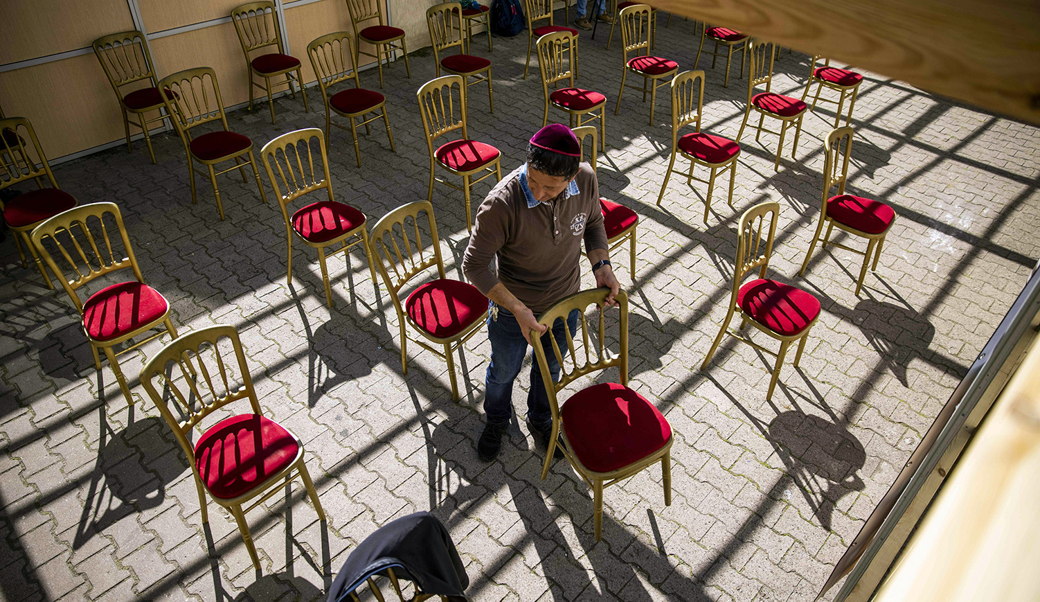 A man setting up for outdoor services on September 18, 2020. ODD ANDERSEN/AFP via Getty Images.