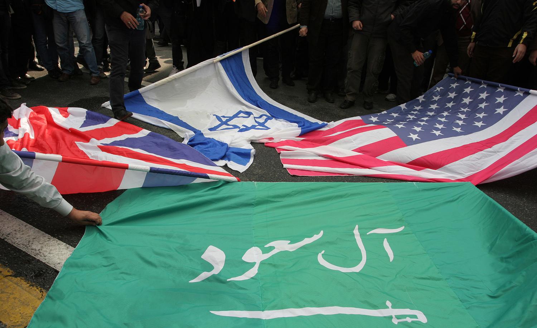 Iranians preparing to burn flags outside the former U.S. embassy in Tehran on November 4, 2015. Mohsen Shandiz/Corbis via Getty Images.
