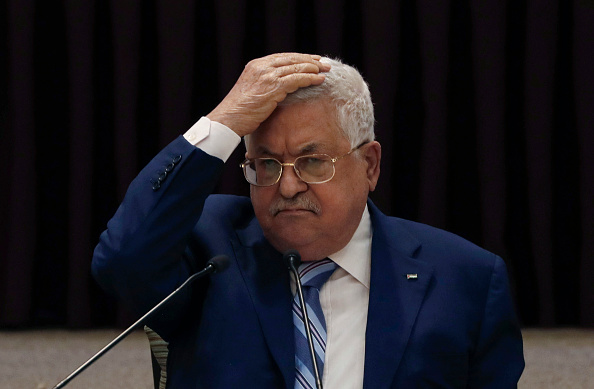 In Ramallah, Mahmoud Abbas puts his hand on his head during a leadership meeting of the Palestinian Authority about the Abraham Accords on August 18, 2020. Photo by Mohamad Torokman/POOL/AFP via Getty Images.