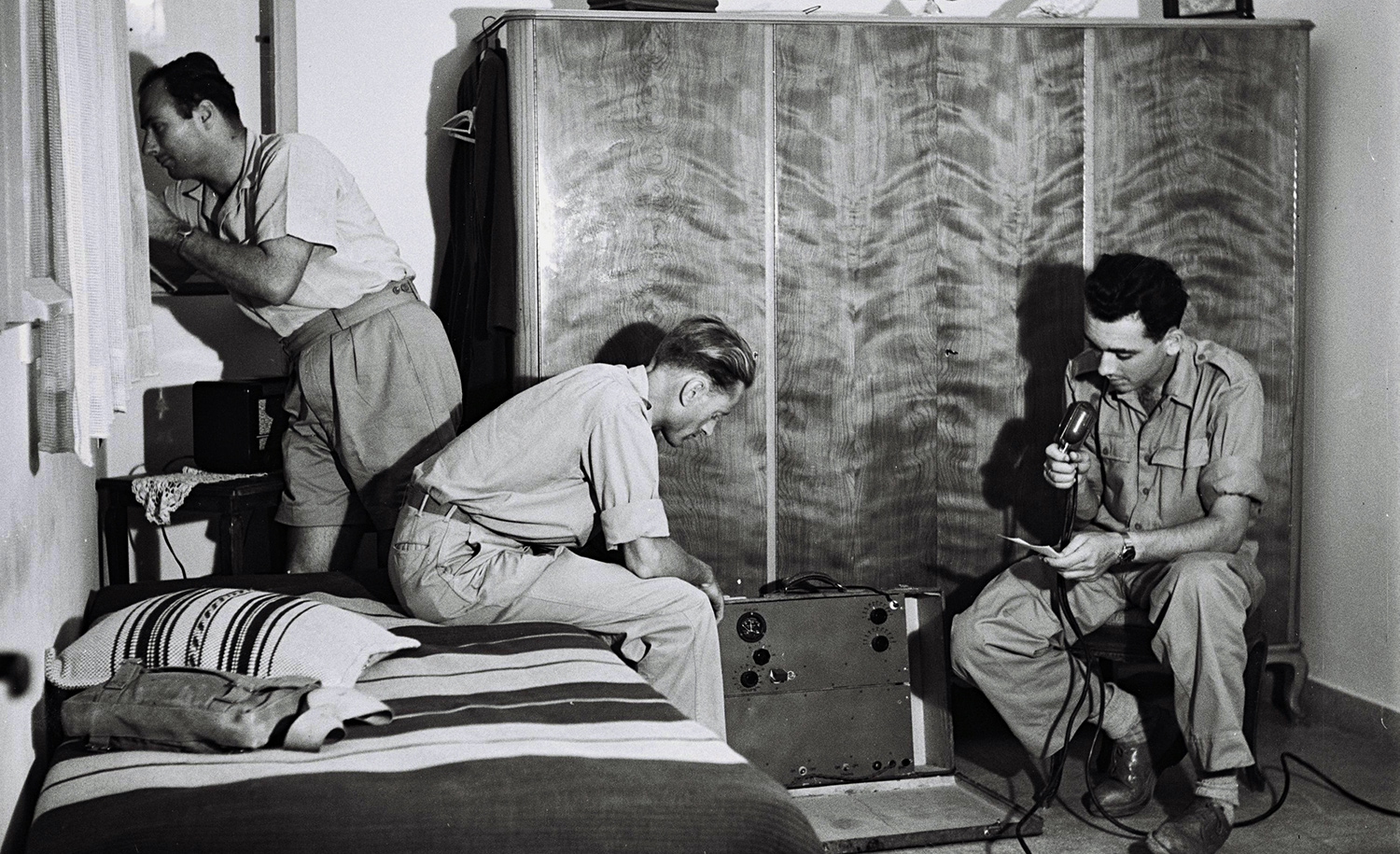 Jewish fighters at their radio in an undisclosed hideout on April 10, 1948, in the weeks before the founding of the state of Israel. Zoltan Kluger/GPO via Getty Images.