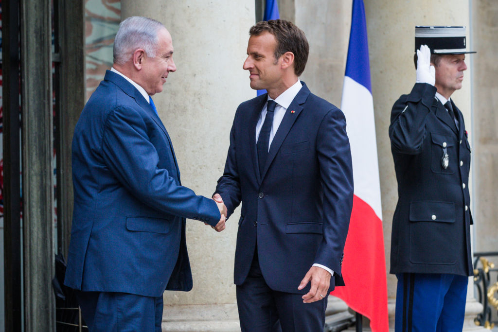 French President Emmanuel Macron welcomes Israeli Prime Minister Benjamin Netanyahu for a meeting at Elysee Palace on June 5, 2018 in Paris, France. Photo by Aurelien Morissard via Getty Images.