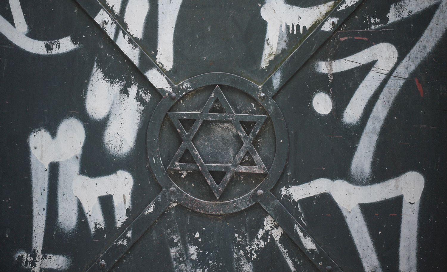 The Star of David surrounded by graffiti on an iron door in Krakow on April 8, 2020. Artur Widak/NurPhoto via Getty Images.
