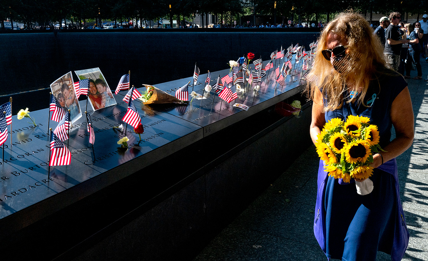 Flags and flowers adorn the names of the victims of the attacks during a ceremony at the 9/11 Memorial and Museum on September 11, 2021 in New York City. Craig Ruttle-Pool/Getty Images.