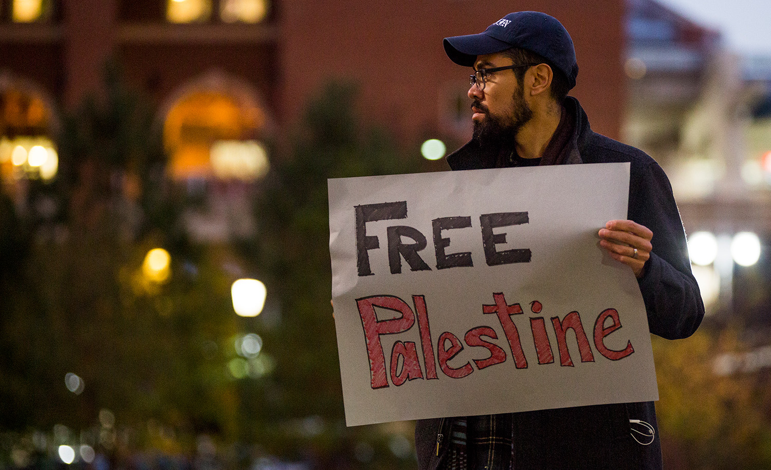 A protester at UNC-Chapel Hill on Nov. 13, 2017, in Chapel Hill, NC. Casey Toth/The Herald-Sun via AP.