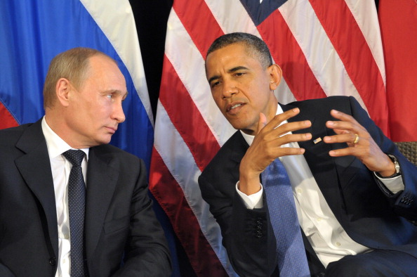 <em>Vladimir Putin and Barack Obama discuss the situation in Syria at the 2012 G20 Summit in Mexico. </em>Photo credit: ALEXEI NIKOLSKY/AFP/GettyImages