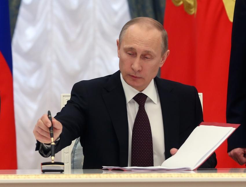 Russian President Vladimir Putin signs bills making Crimea part of Russia, Friday, March 21, 2014. Photo credit: AP/Sergei Chirikov.