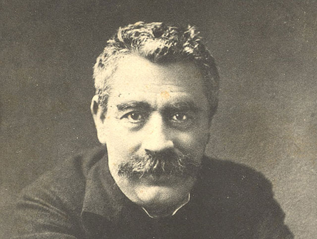 <em>A postcard featuring I.L. Peretz, one of the founders Yiddish culture, circa 1923.</em> Wikimedia.