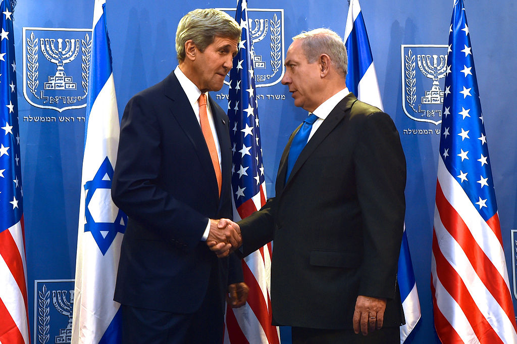 U.S. Secretary of State John Kerry shakes hands with Israeli Prime Minister Benjamin Netanyahu in Tel Aviv on July 23, 2014, before the two sat down to discuss a possible cease-fire to stop Israel's fight with Hamas in the Gaza Strip. Photo by the U.S. Department of State.