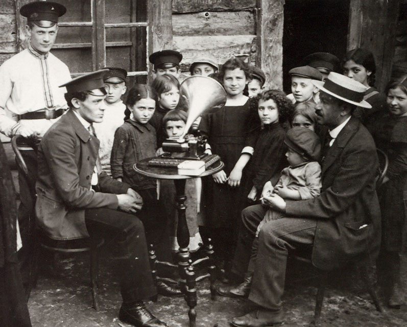 The folklorist Zusman Kisselhof recording Yiddish songs in a shtetl in Kremenets, Ukraine, in 1912.