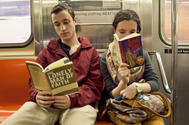 A Modern Orthodox boy reads Joseph B. Soloveitchik's The Lonely Man of Faith on the New York City subway. Photo courtesy Ourit Ben-Haim.