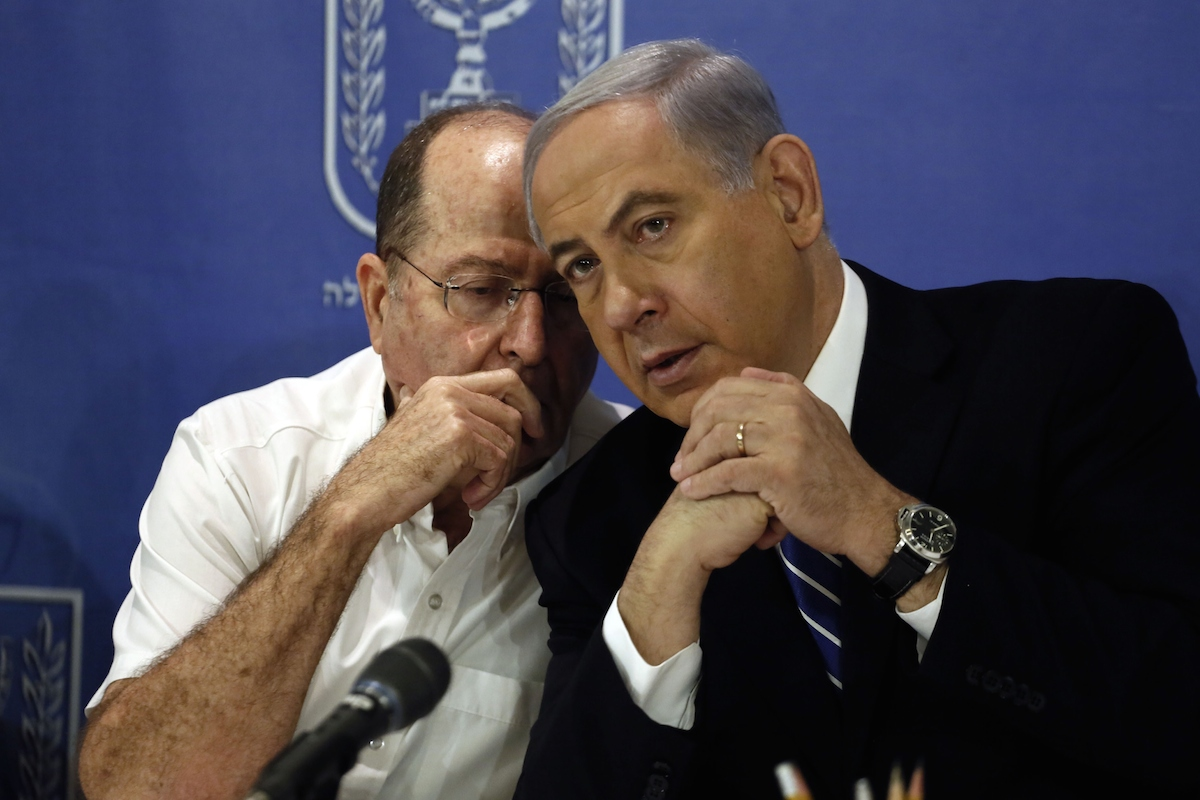 <em>Israeli Prime Minister Benjamin Netanyahu listens to Defense Minister Moshe Yaalon during a cabinet meeting on August 24, 2014.</em> Photo by GALI TIBBON/AFP/Getty Images.