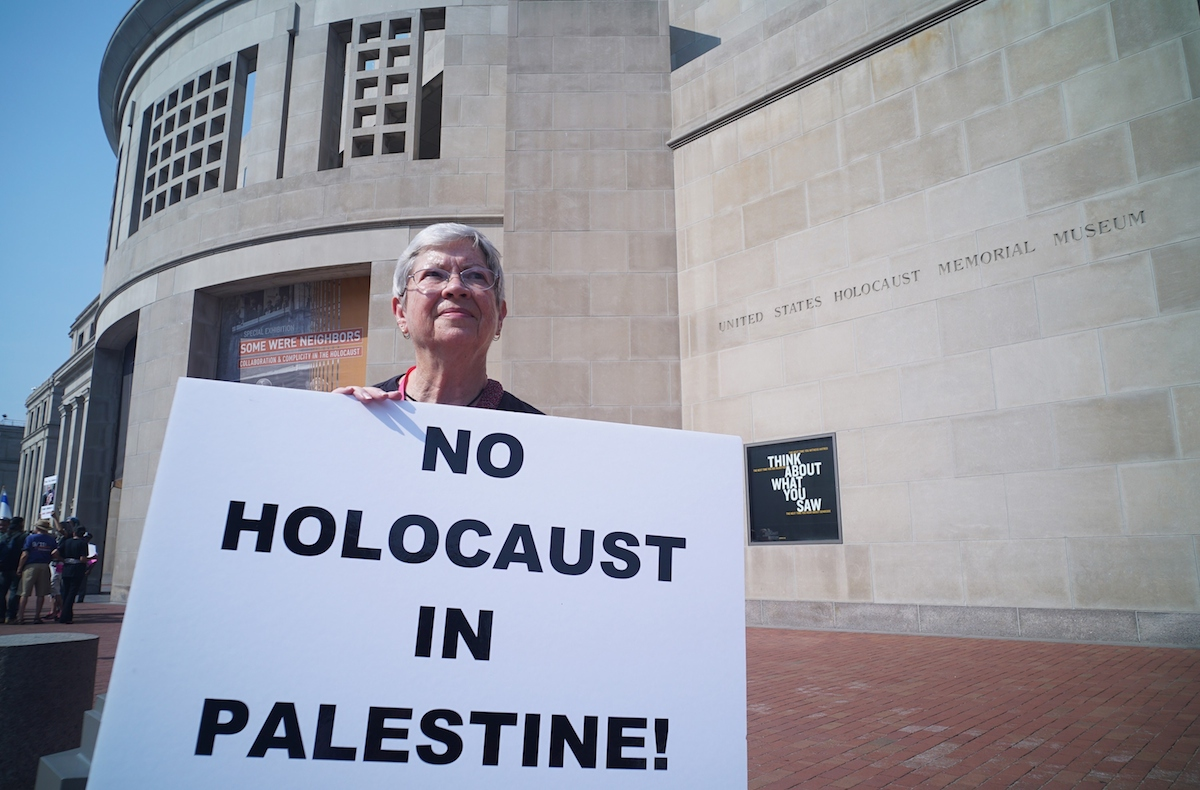 <em>A woman demonstrating against Israeli action in Gaza outside of the Holocaust Museum in Washington, DC.</em> Photo by MANDEL NGAN/AFP/Getty Images.
