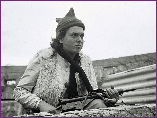 <i>A Youth Aliyah girl on guard duty.</i> Courtesy Government Press Office.